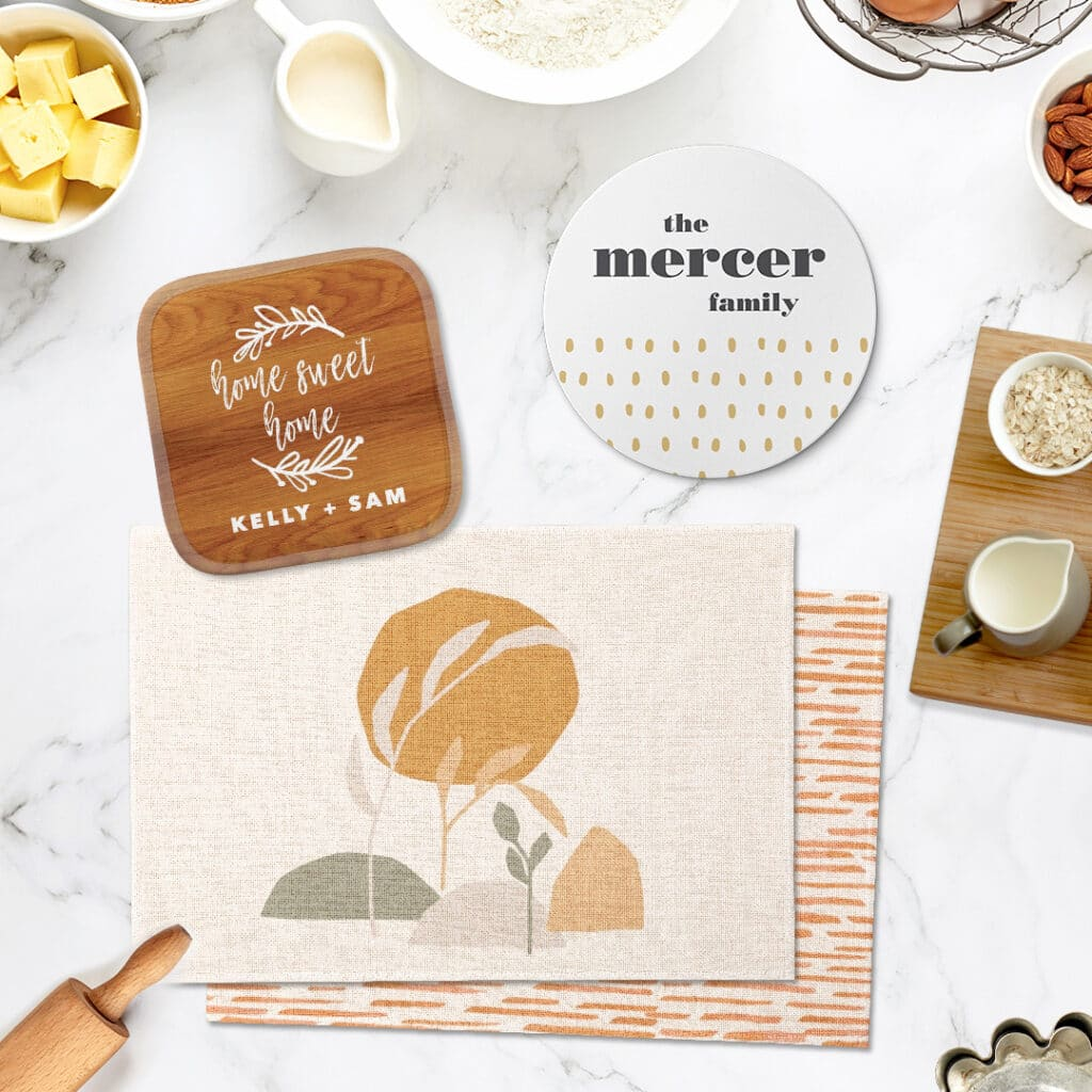 Kitchen accessories including pot holder, trivet, and placemats in bright, warm neutrals
