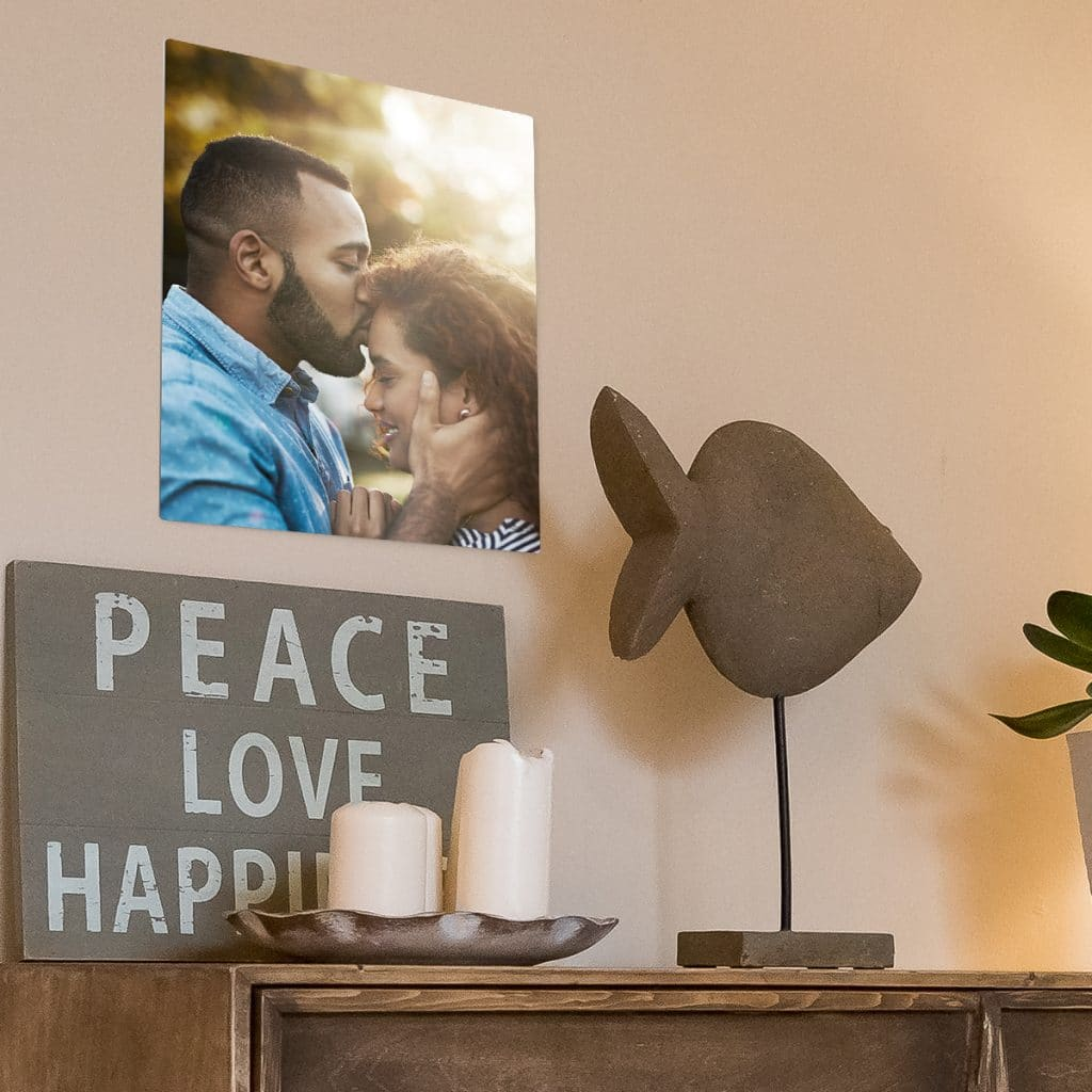 Metal photo print hanging on a wall surrounded by beautiful decor