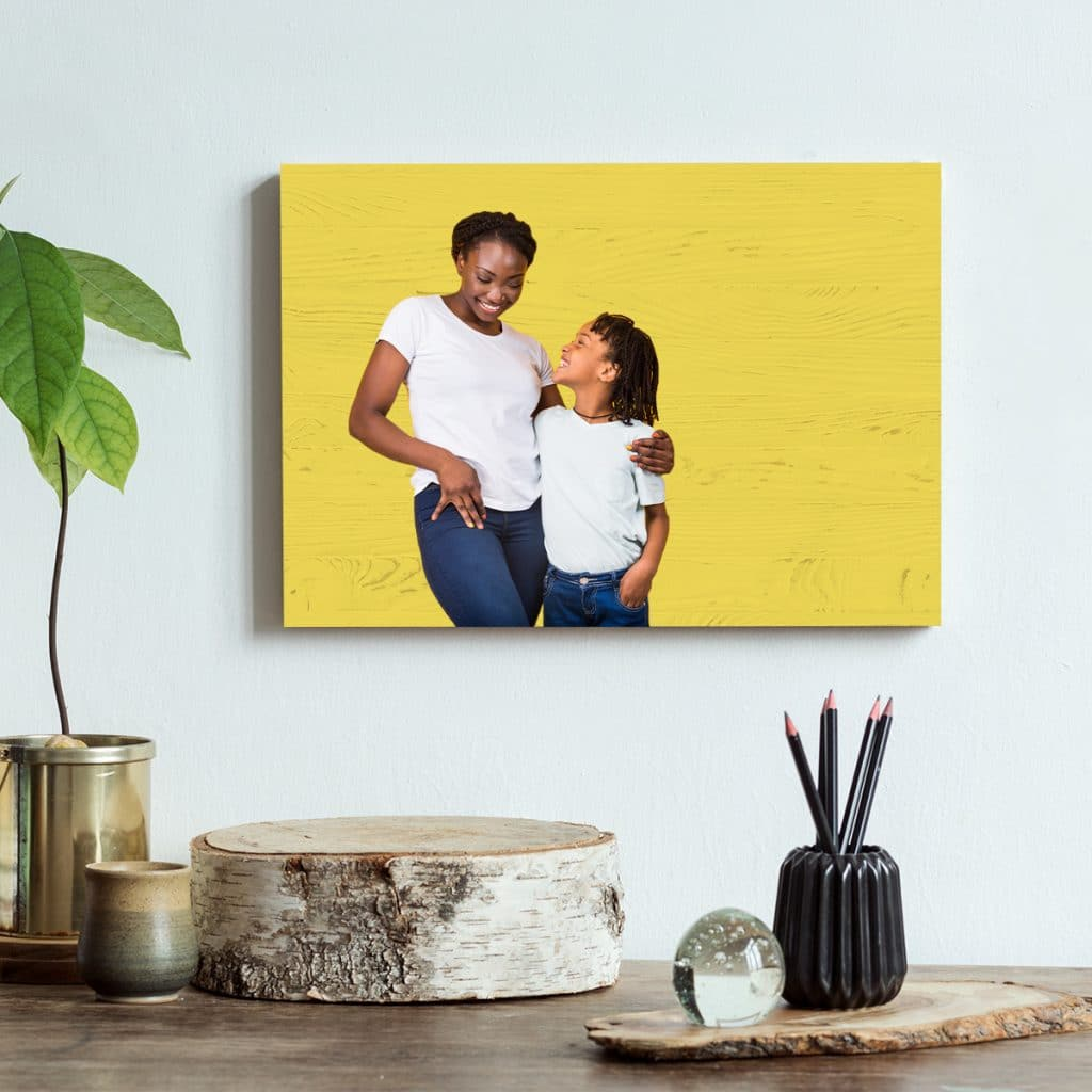 DIY wooden photo display hanging on the wall over a table