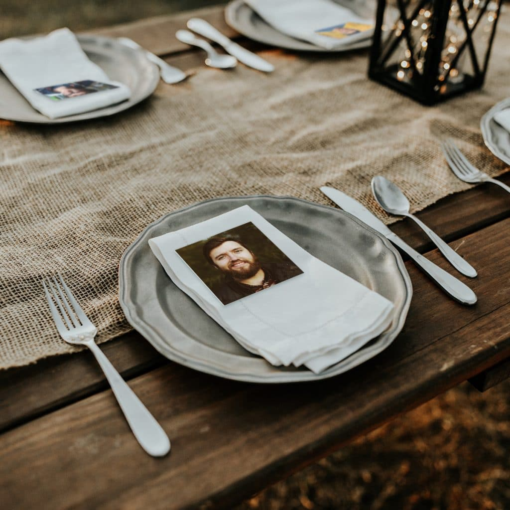 Square photo print being used as a wedding place card