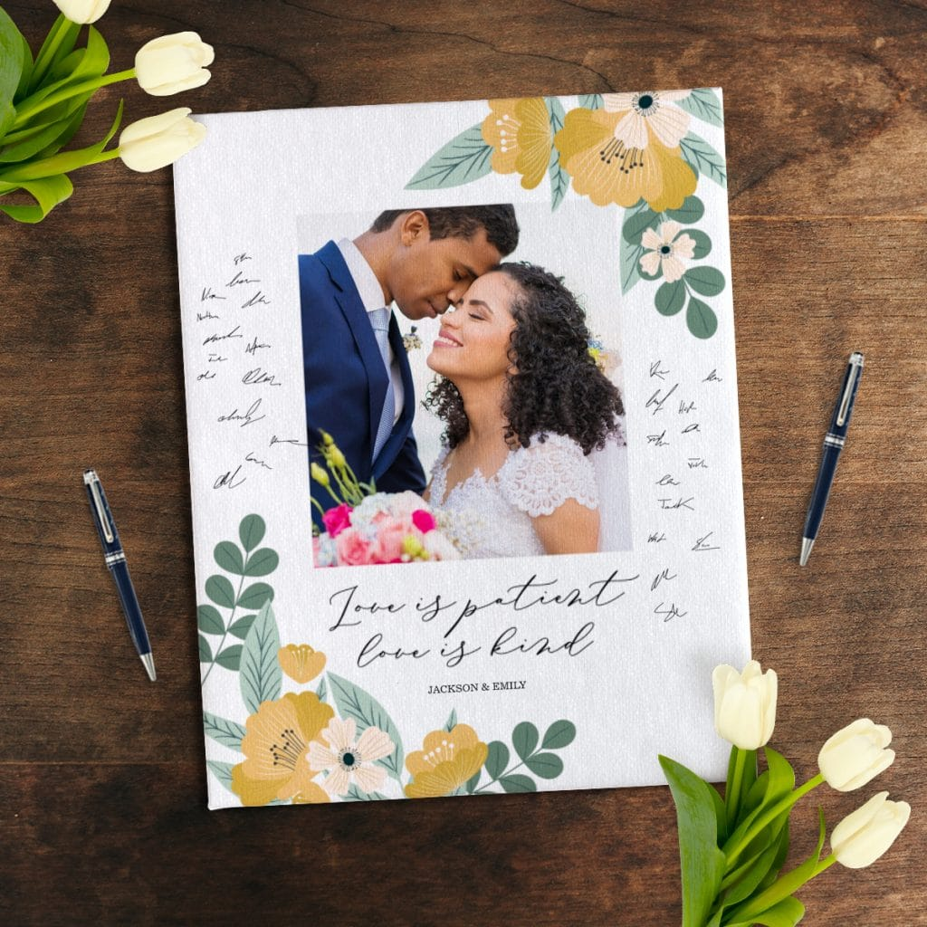 Photo canvas being used as a wedding guest book, covered in signatures