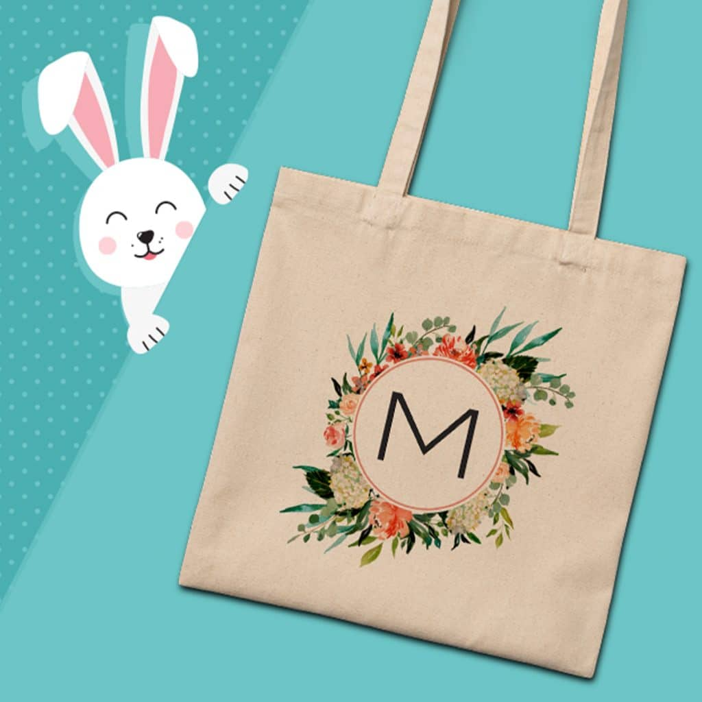 Everyday canvas tote bag with floral design around a letter M