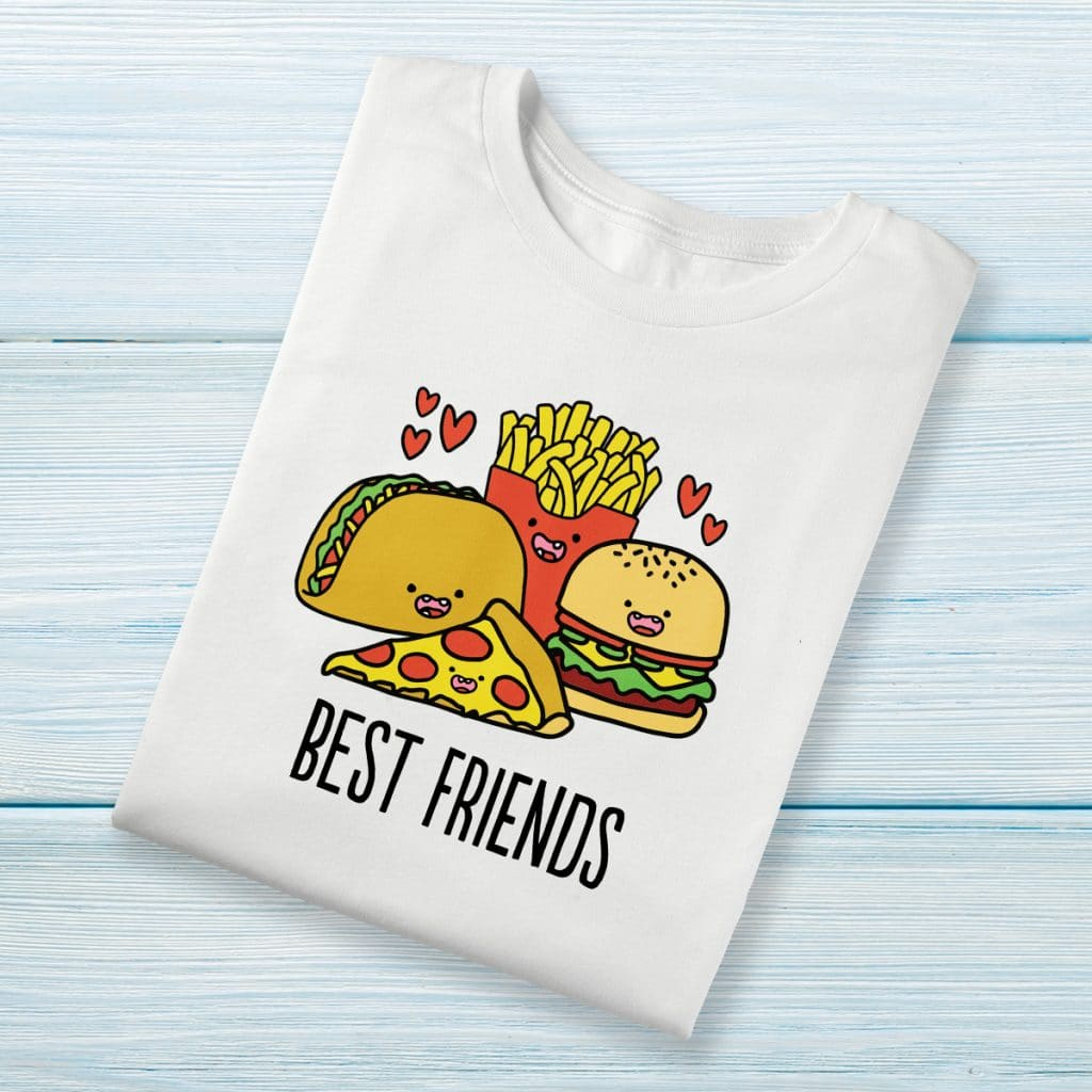 """White t-shirt featuring a cartoon-style design of a taco, a burger, a piece of pizza, and fries that reads """"BEST FRIENDS"""""""