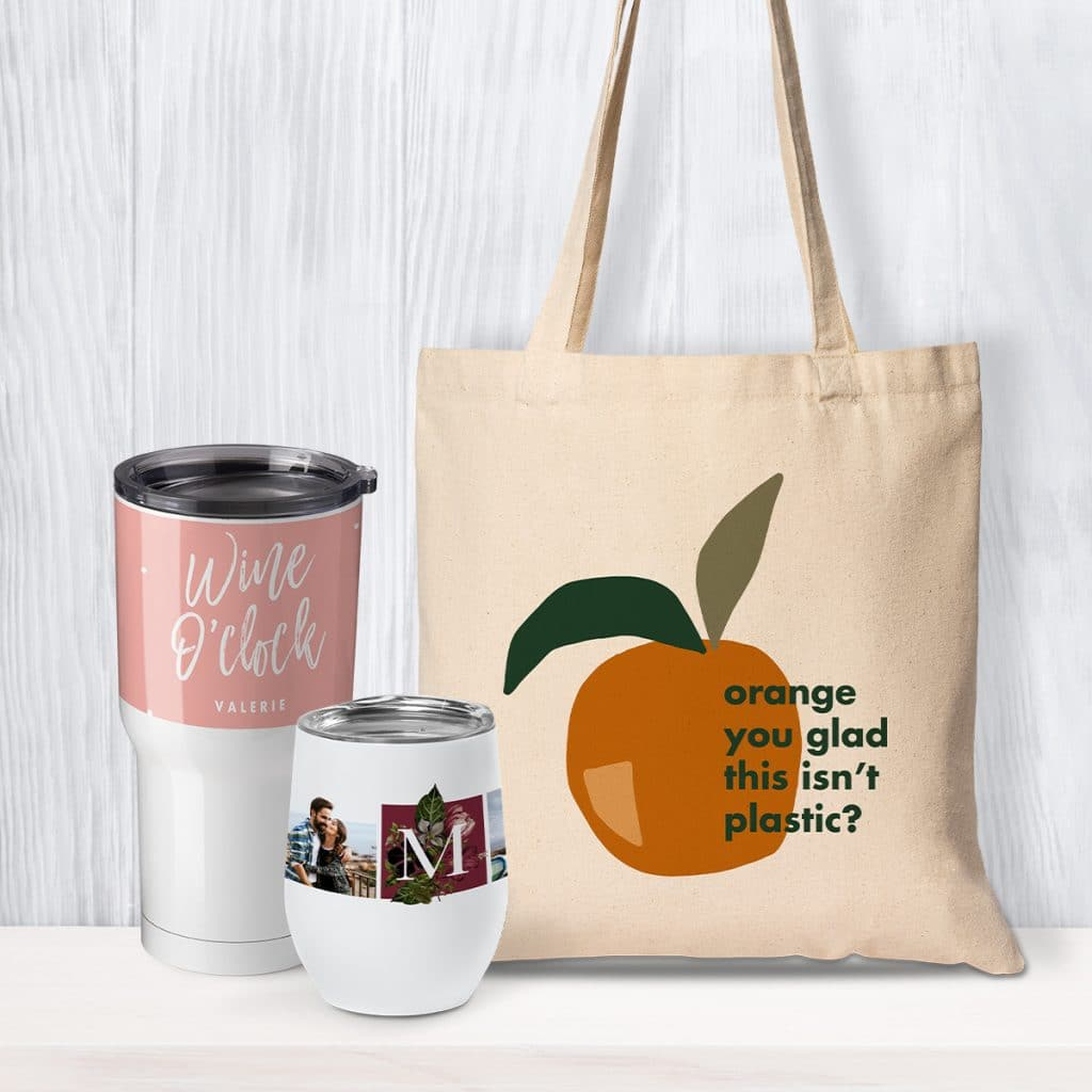 Insulated drinkware and a custom canvas tote bag leaning against a wall
