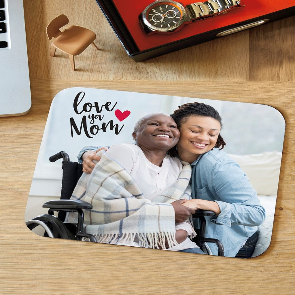"""Mousepad featuring photo of mom and daughter hugging with an embellishment that reads """"Love you mom"""""""