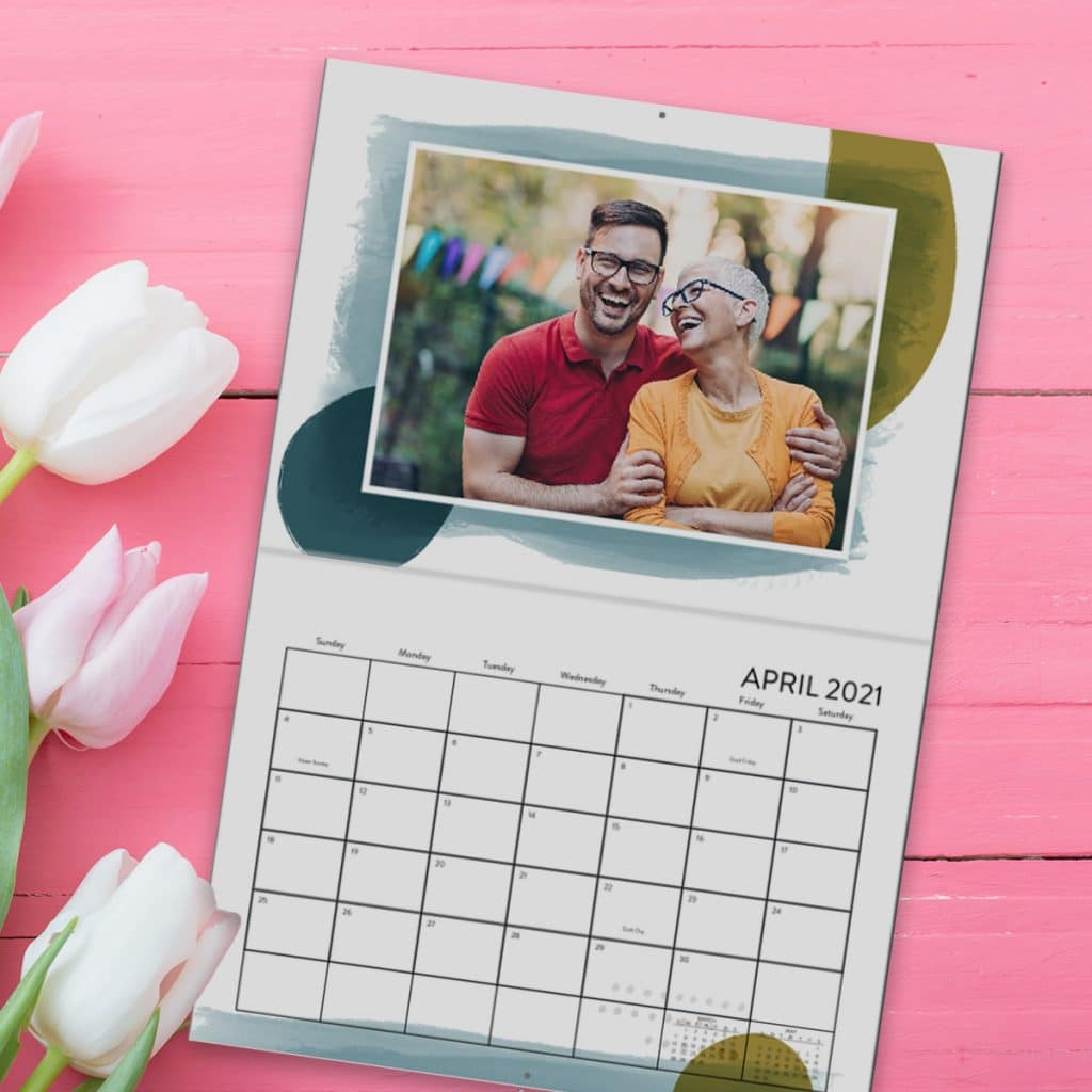 Wall calendar showing April 2021 featuring a photo of a mother and her adult son