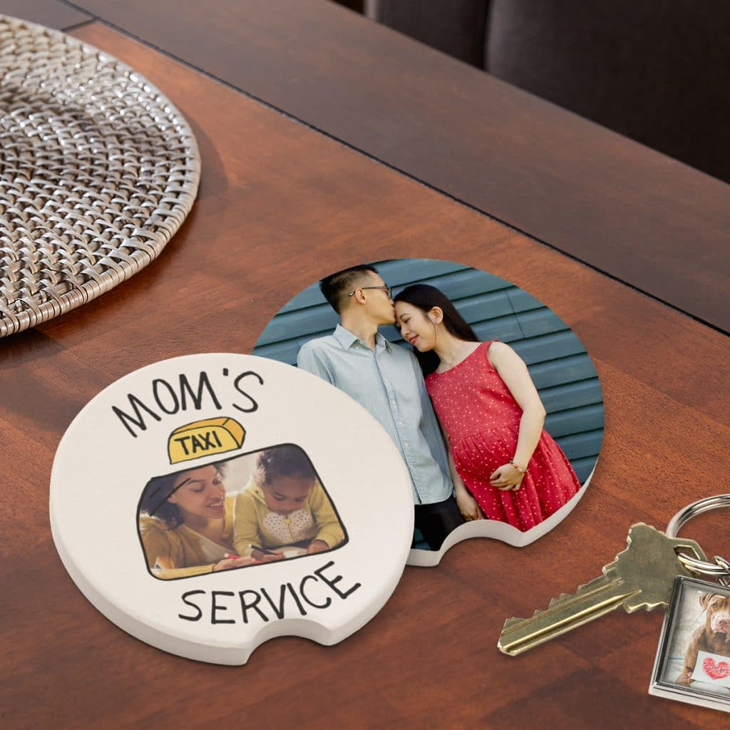 """Car coasters featuring """"Mom's Taxi Service"""" design and a full photo option sitting on a table next to a set of keys"""