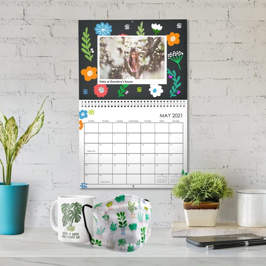 Plant-inspired designs on a mug, face mask, and hanging wall calendar