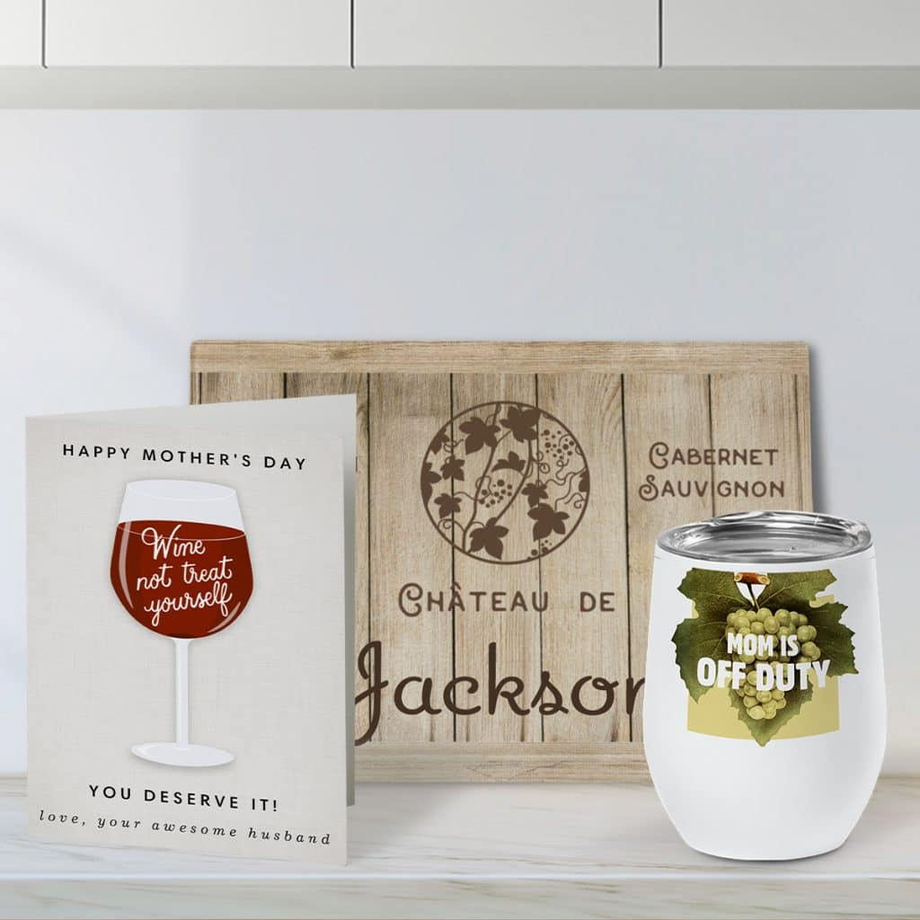 Wine-themed Mother's Day card with a glass cutting board featuring the wine crate design, and an insulated wine tumbler showcasing a custom grape design