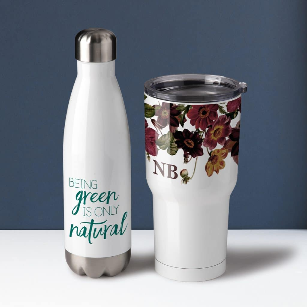 """Insulated water bottle that reads """"Being green is only natural"""" and an insulated tumbler with a moody floral design."""