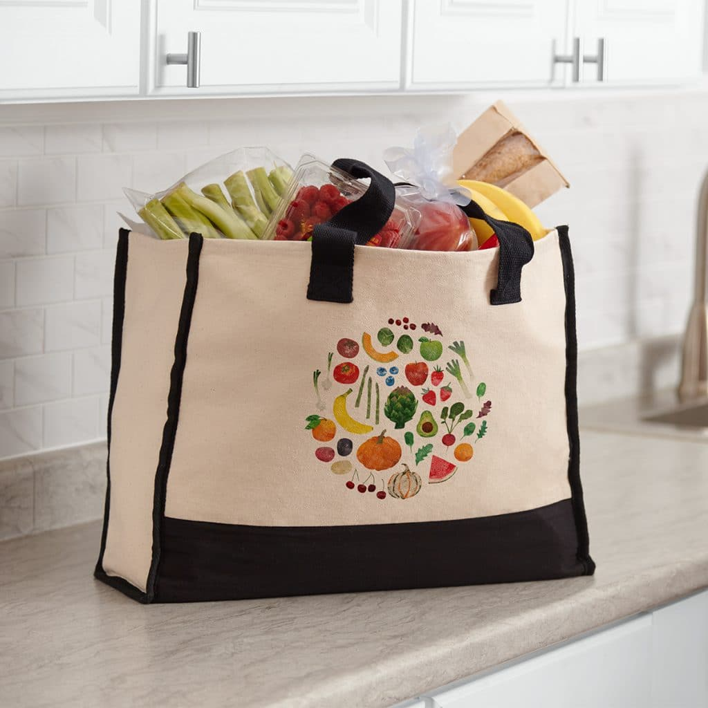 Large premium cotton tote sitting on a counter full of groceries
