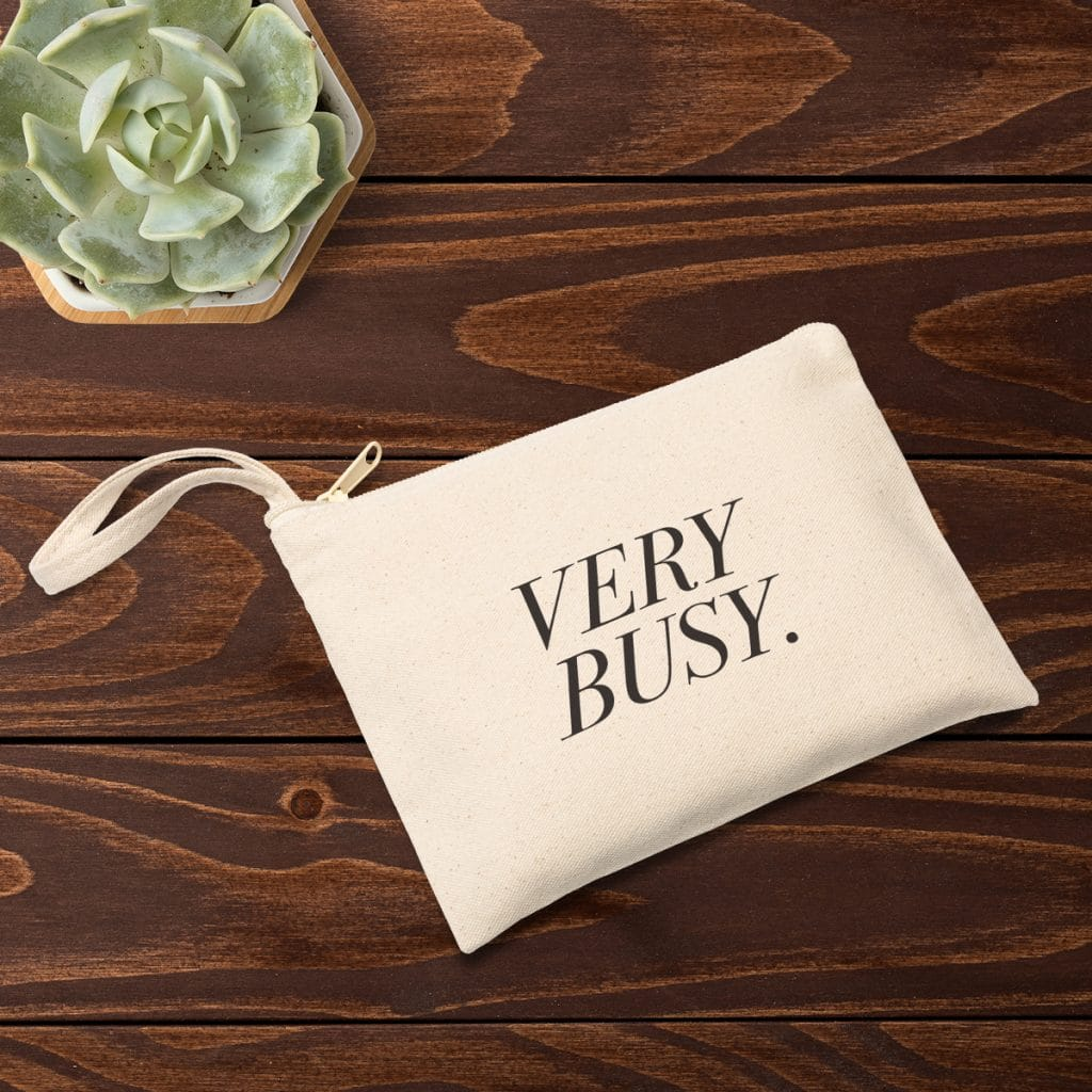 """Zippered canvas pouch with """"VERY BUSY."""" design"""