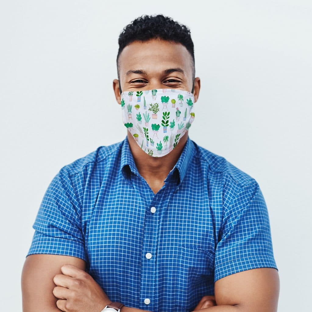 Man wearing a custom face mask with house plant pattern design
