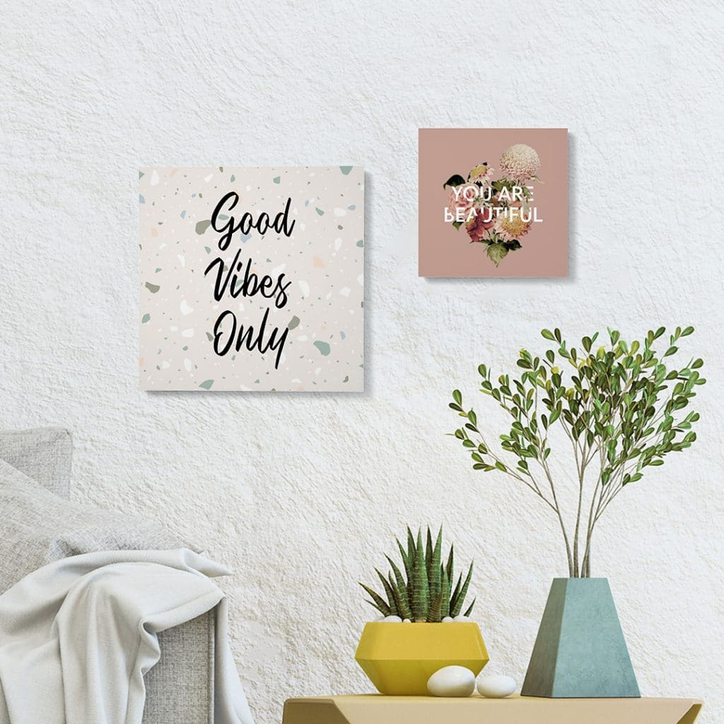 12x12 and 8x8 square photo tiles hanging on a wall