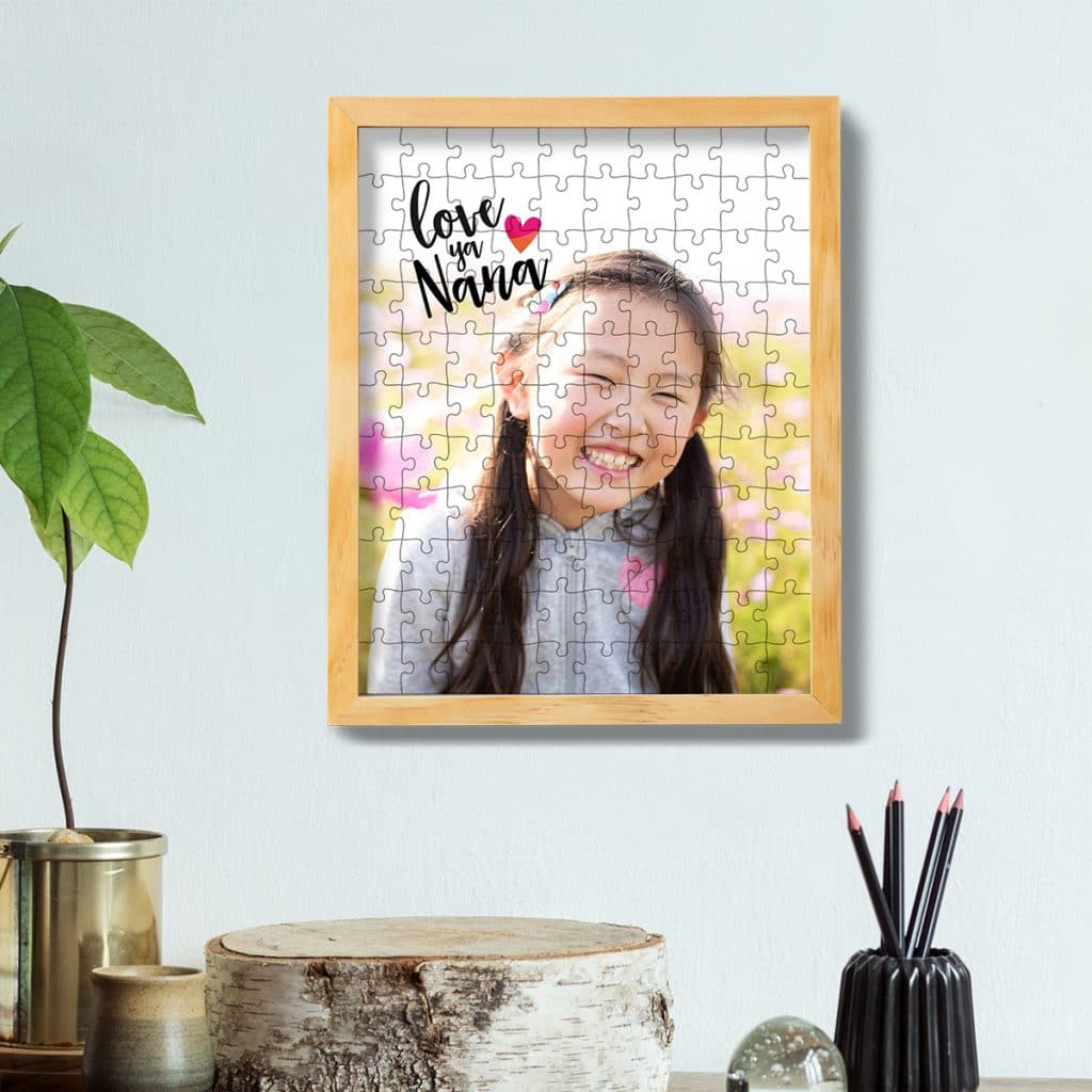 110 piece photo puzzle featuring smiling girl framed and hung on a wall