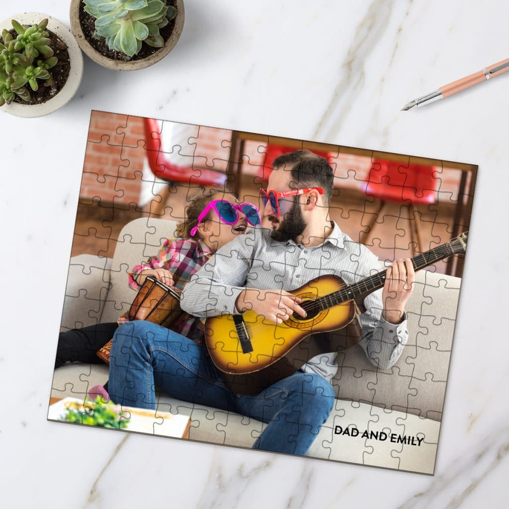 Photo puzzle showcasing dad playing guitar and wearing silly glasses with his daughter