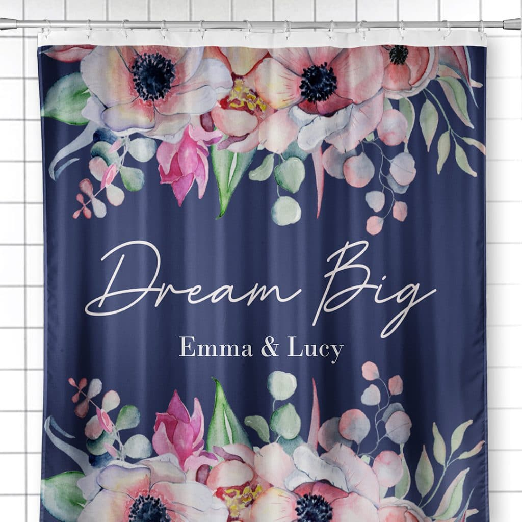 """Photo of shower curtain featuring Dream Big floral design and the names """"Emma & Lucy"""""""