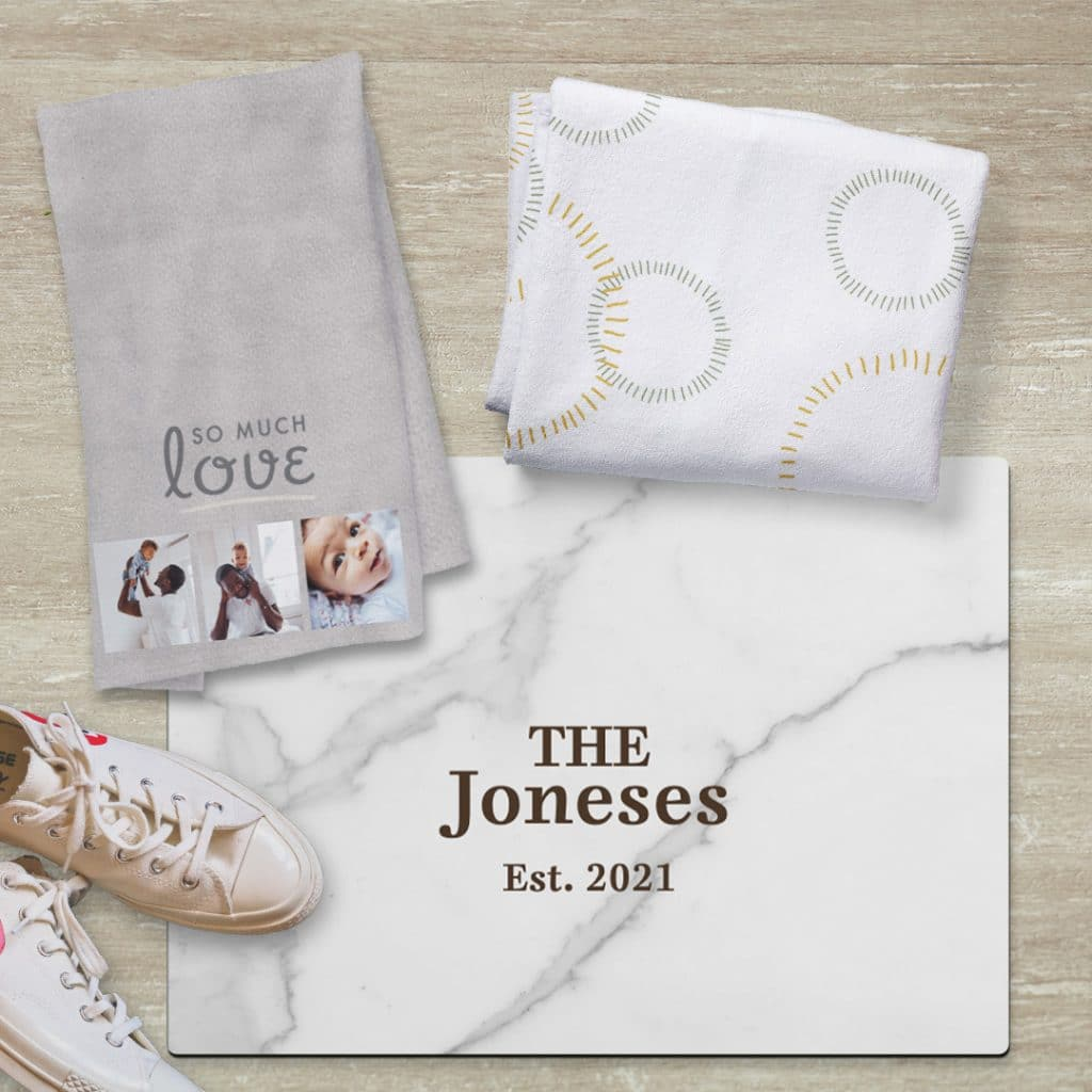 Image of towels and a bathroom floor mat featuring gray and marble designs