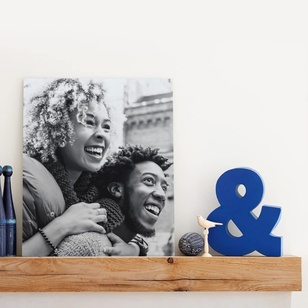 Photo featuring a metal photo print sitting on a shelf next to other décor items
