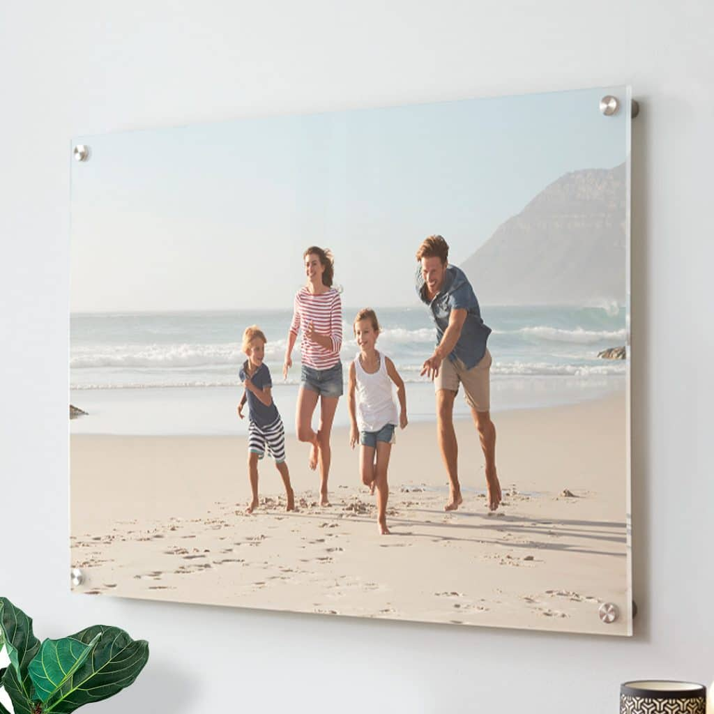 Image of acrylic photo print of family on a beach