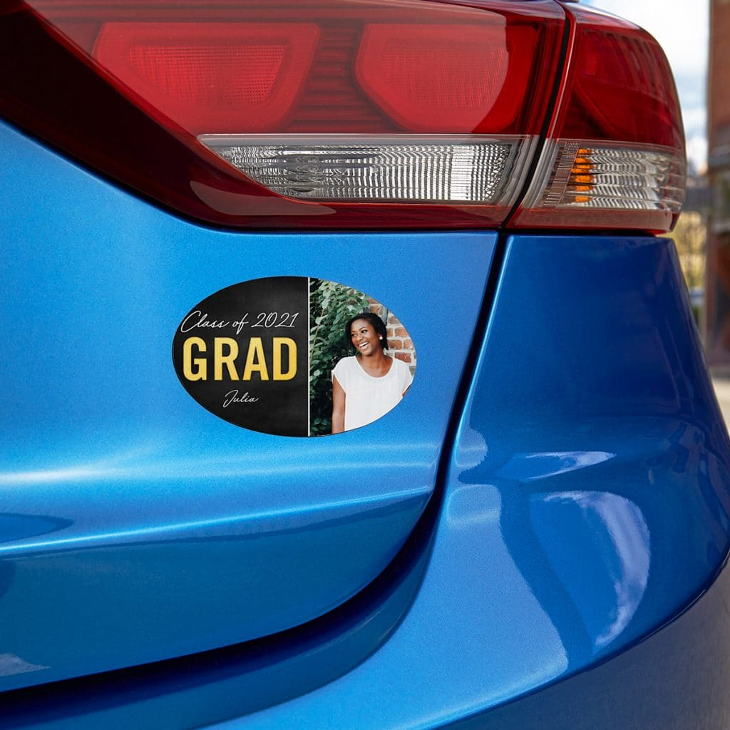 Oval-shaped car magnet featuring 2021 grad Julia and senior portrait on the bumper of a blue car