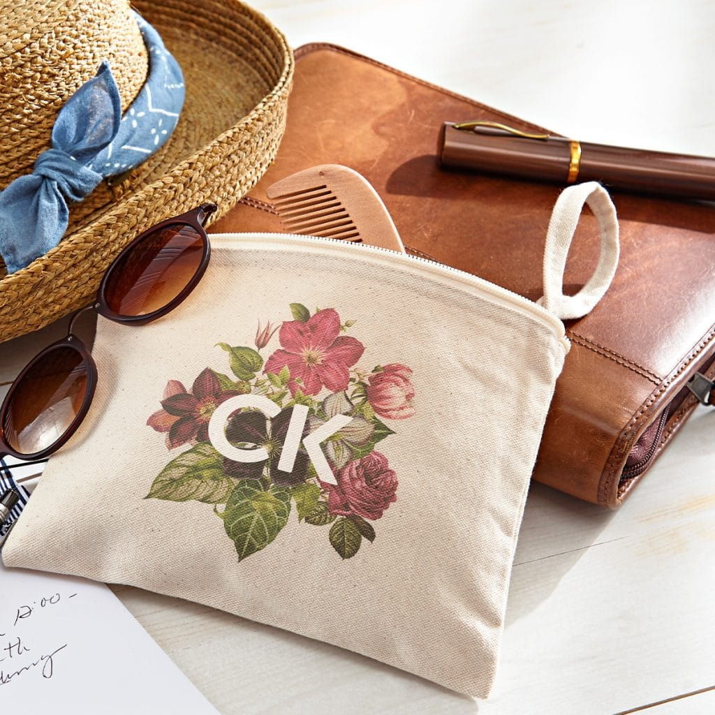 Zippered canvas pouch with floral monogram design