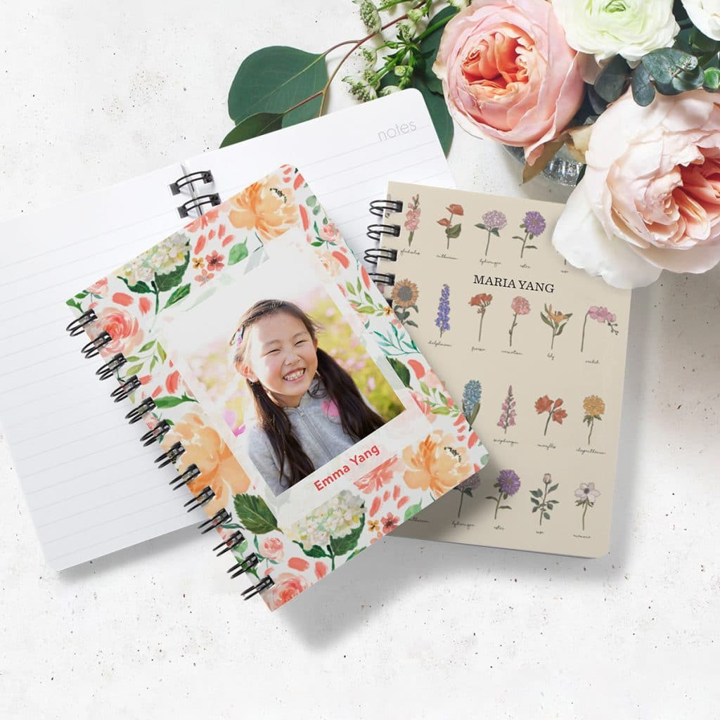 Floral inspired spiral notebooks laying on a desk