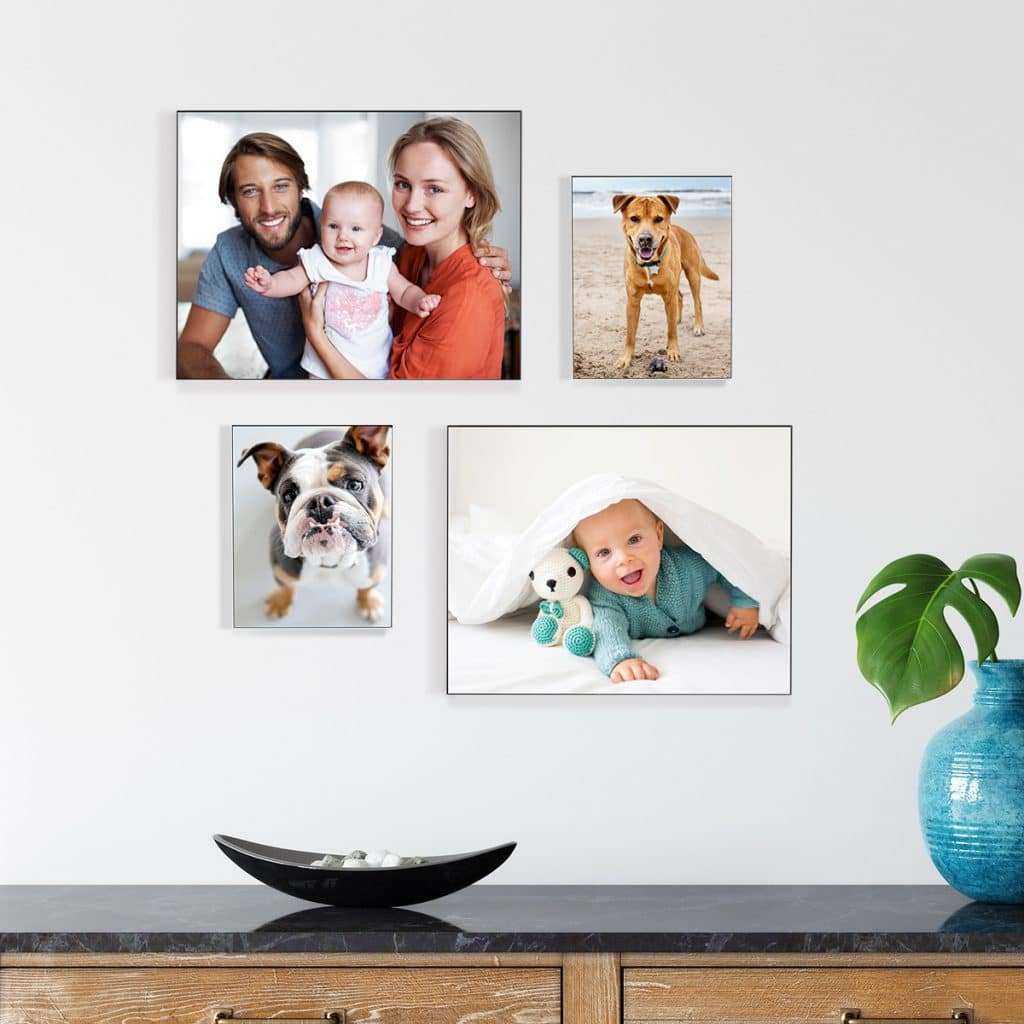 Image of a wall featuring 4 metal photo panels featuring sweet family photos
