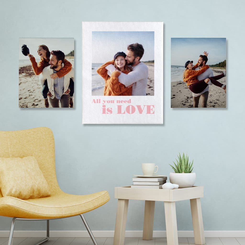 Image of 3 canvas prints hanging over a chair and small table. The canvas prints feature images of a happy, carefree couple.