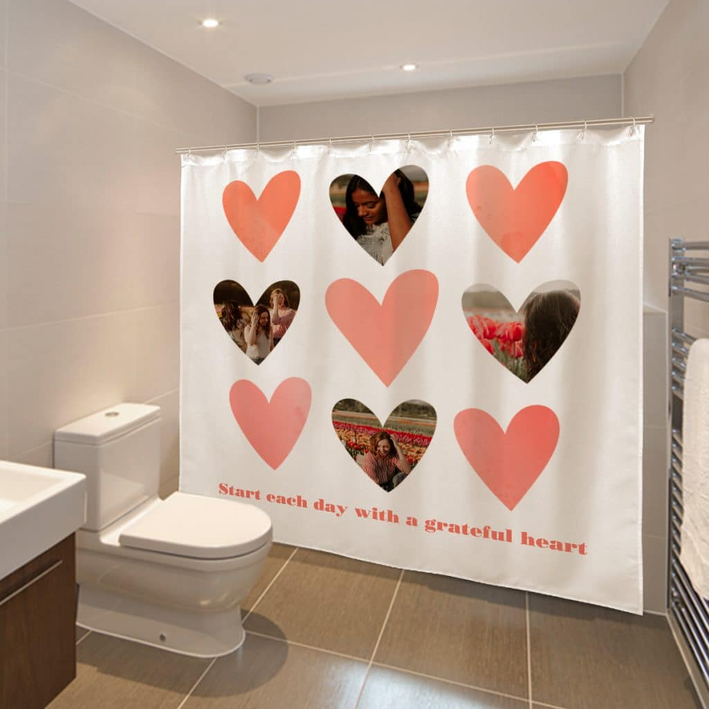 """Image of a bathroom with a custom shower curtain reading """"Start each day with a grateful heart"""""""
